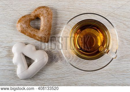 Brown Gingerbread In Shape Heart, Gingerbread In Shape Spruce, Transparent Cup With Tea On Saucer On