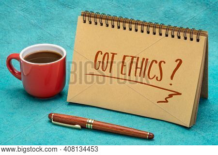 Got ethics? Are you ethical question. Handwriting in a spiral notebook with a cup of coffee.