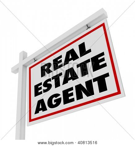 The words Real Estate Agent on a home or house for sale sign advertising an agency and its professional services aimed at selling or buying property