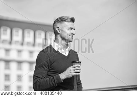 Enjoy The Little Things. Handsome Man Enjoy Drinking Coffee On Blue Sky. Caucasian Guy Hold Takeaway
