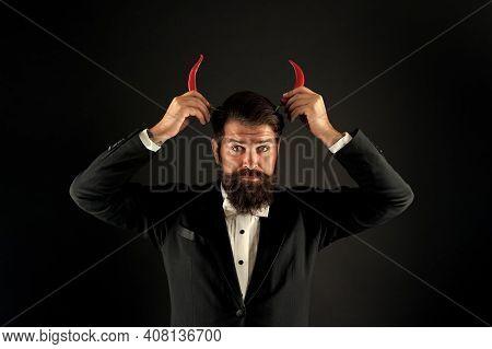 Hot As Hell. Handsome Macho Likes Taste. Man Hold Pepper Harvest. Red Horns. Stubborn Bearded Busine
