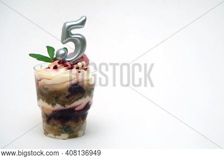 Birthday Trifle Cake With Candle Labeled Number 5 On White Background. Portioned Mini Cake With Copy