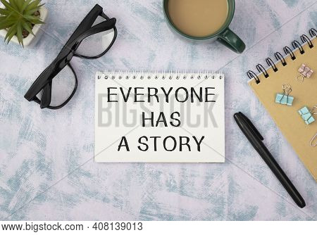 Everyone Has A Story Text On Notepad