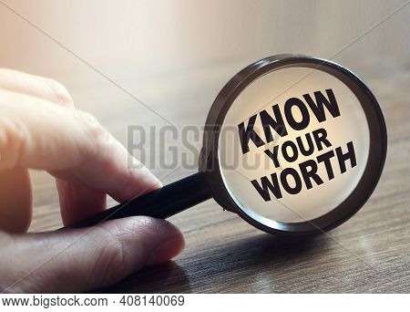 Know Your Worth Under Magnifying Glass On Wooden Table. Career Concept. Self Motivation Coaching Hr
