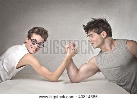 Nerd is wrestling with a muscular guy poster