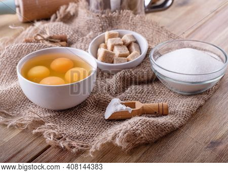 Baking Ingredients For Baking On A Wooden Table