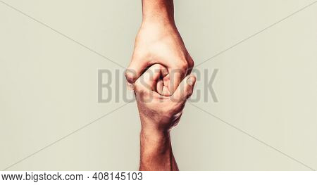 Helping Hand Outstretched, Isolated Arm, Salvation. Close Up Help Hand. Helping Hand Concept And Int