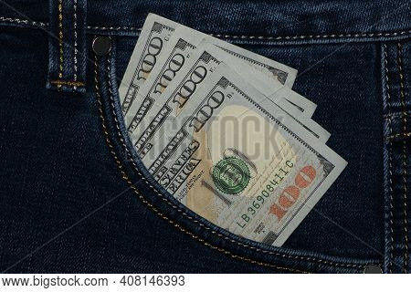 Money In Your Pocket. Dollar Bills In Jeans Pocket. The Concept Of Pocket Money. Cash. American Mone