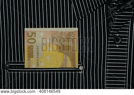 Money In Your Pocket. Banknote 50 Euros. Pocket Of Striped Shirt And European Money In It. Cash Paym