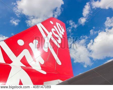 Manila, Philippines - September 25, 2018: Airasia Logo On The Tail Of Airplane Against Sky. Airasia