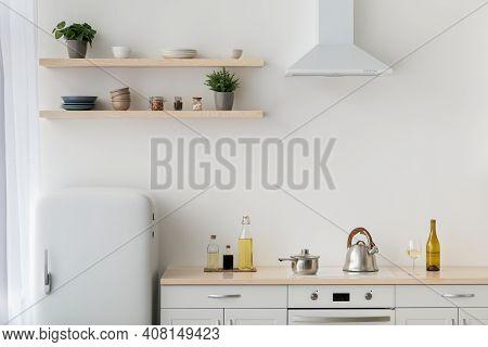 Modern Minimalist White Kitchen In Scandinavian Style, Simple, Minimalist Interior. Refrigerator, Sh