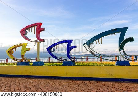 Puerto Princesa, Palawan, Philippines - September 26, 2018: Colored Fishes Installed On The Embankme