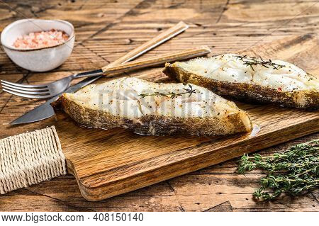 Baked Halibut Fish Steak. Wooden Background. Top View
