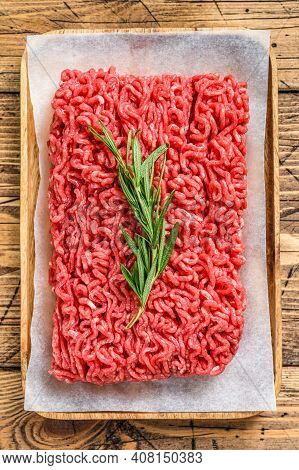 Fresh Raw Mince Beef, Ground Meat On Butcher Paper. Wooden Background. Top View