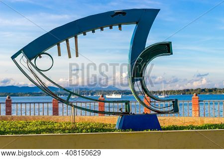 Puerto Princesa, Palawan, Philippines - September 26, 2018: Fish Sculpture Against Seascape In The E
