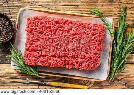 Raw Mince Ground Meat. Wooden Background. Top View