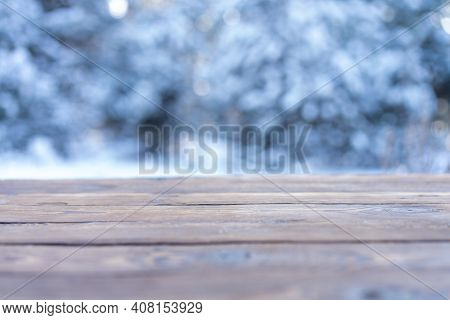 Beautiful Winter Scene. Blurred Background Of Snowy Christmas Nature Background, Wood Table Top On S
