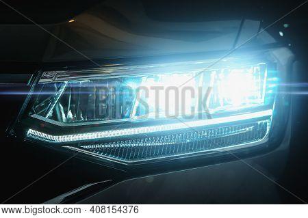 Car Led Headlights In Night. New Modern Car Headlamp, Close Up.