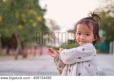 Portrait Of Cute Asian Happy Little 2 Years Old Toddler Baby Child Girl Looking At And Camera And Sm