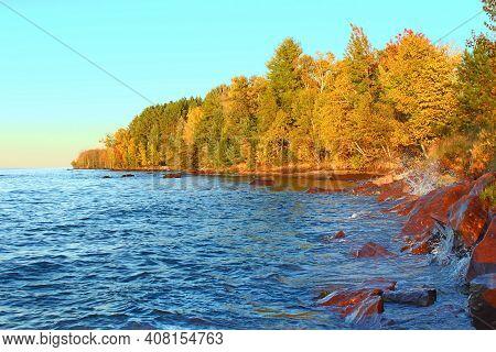 Waves Crash Along A Rocky Shoreline Of Lake Superior In Ontonagon County Michigan