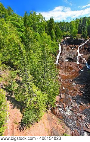 Eagle River Falls Cascades Down A Rocky Cliff In The Keweenaw Peninsula Of Michigan