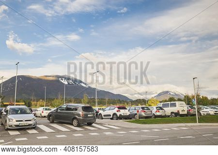 Lesce, Slovenia, October 2020: Car Parking With Views Of The Julian Alps In Slovenia