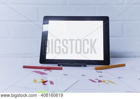 Creative Workplace Of A Graphic Designer With Tablet. Development Of A Logo For The Company. Drawing