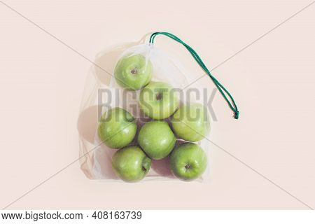 Reusable Packaging Of Products By Weight. Apples In A Reusable Bag Close Up On A Pink Background