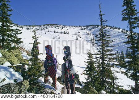 The Khamar -daban Range, Siberia, Russia - 11.02.2013: Freerider Snowboarders Walking In Winter Snow