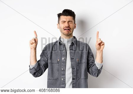 Sad And Miserable Guy Crying While Pointing Fingers Up, Showing Disappointed Promo, Sobbing And Whin