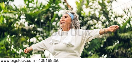Portrait Of Happy Senior Old Adult Elderly Asia Women Smiling Standing And Stretch Her Arms Relax An
