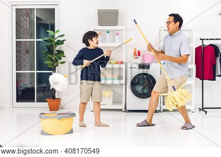 Father Teaching Asian Kid Little Boy Son Having Fun Doing Household Chores Cleaning And Washing Floo