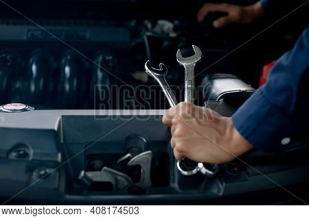 Car Service, Repair, Maintenance Concept. Auto Mechanic Working In Garage.