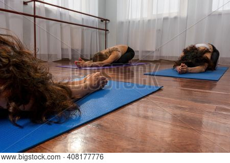 Group Of Young Womans Fitness Instructor In Sportswear Leggings And Tops, Stretching In The Gym Befo