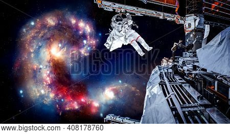 Astronaut Spaceman Do Spacewalk While Working For Space Station In Outer Space . Astronaut Wear Full