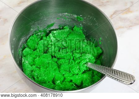 Making Batter For Green Saint Patrick`s Day Cookies By Mixing Ingredients Of Flour Butter Egg And Gr