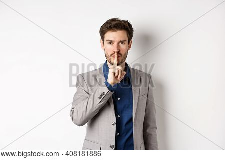 Handsome Macho Man In Suit Shushing At Camera, Press Finger To Lips, Ask Keep Voice Down, Tell Secre