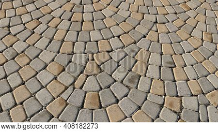 A Fragment Of A Paved Street Surface With Light Stone Cobblestones With Rounded Edges, A Full-frame