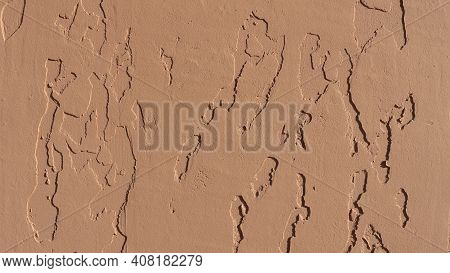 Texture Background Of Peach-beige Shade With Abstract Indentations On The Surface Of Decorative Plas