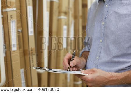 Manager Use His Tablet For Online Checking Products Available
