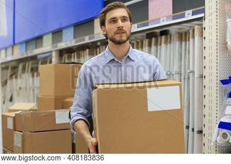 Portrait Of A Smiling Warehouse Keeper At Work.