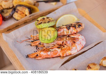 Cooked Fresh Red Langoustine Shrimps, Prawns In Paper Take Out Box At Summer Local Food Market - Clo