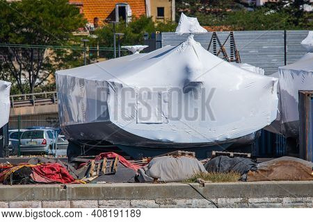 Shrink-wrapped Boats Stored Ashore In Pvc Film And Winterized.
