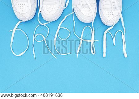Two Pairs Of Matching White Sneakers With The Lettering