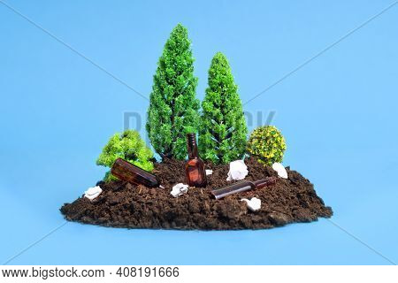 Miniature Toy Forest Setup With Paper Rubbish, Tiny Glass Bottles Lying Around.the Concept Of Safe D