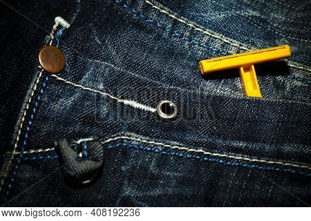 Old Jean Pant And Razor Blade On Pocket Photo