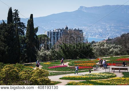 The Parade Of Tulips In The Nikitsky Botanical Garden Yalta On April 07, 2018. People Walk Among The