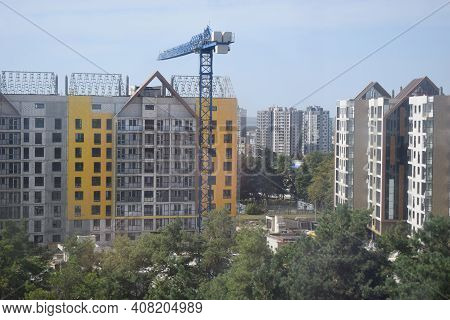 Construction Of The New Of A Residential Apartment Complex. Construction Site With Crane On Sky Back