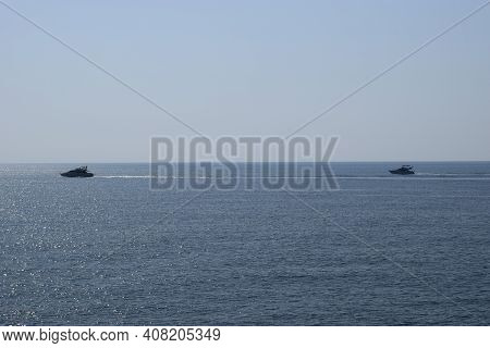 Sea Scene Modern Vessel. Yacht Vacation Modern Vessel. White Yachts Floating In The Mediterranean Se