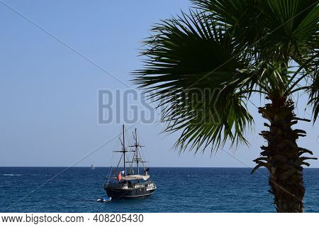 Old Pirate Ship Sailing In The Deep Sea. Pirate Ship At Sea. Horizon In The Sea. A Pleasure Ship In